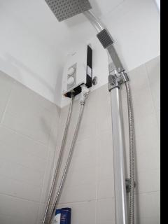 Shower with water heater