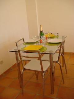 Dining seats 4 plus additional chairs for more guests