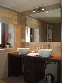 Family bathroom with His & Hers twin Travertine basins