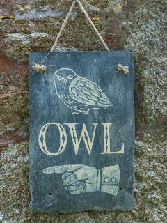 a handpainted sign made by Suzy Currell in the village!