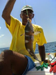 Ambrose catches a grouper for dinner