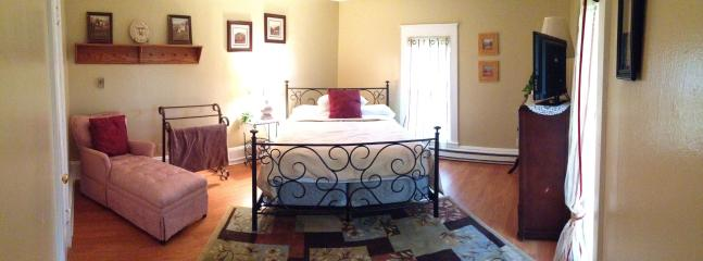 Large upstairs bedroom with a queen sized bed