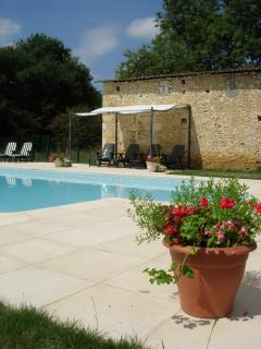 Heated swimming pool with terrace and gazebo.