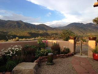 From the private, enclosed courtyard - a view east - evening light on the Sangre de Cristo Mts.