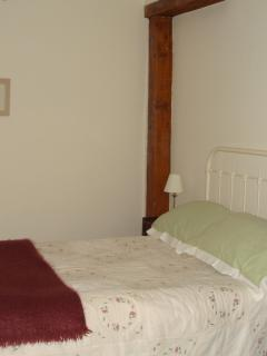 Cosy double bedroom with antique bed and view of the garden