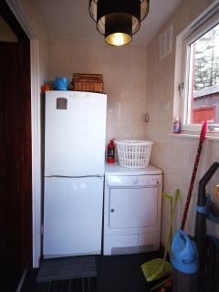 Utility room with drier and fridge freezer