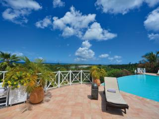 Beautiful 5+2 bedroom villa located in the prestigious gated community of Terres Basses, giving lovely views over Baie Longue and the Caribbean Sea.