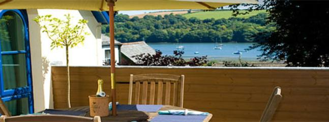 Enjoy watching the boats glide by while you take in the long Cornish evenings!