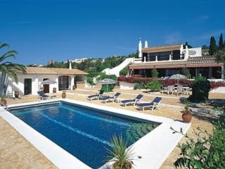 View of swimming pool, pool house and villa