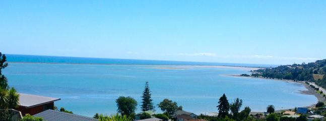 View over towards Tasman Bay from house with tide coming in