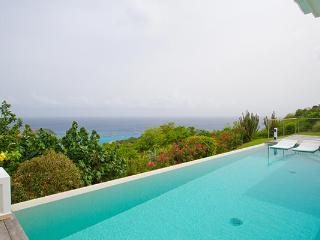 Perched hillside with splendid view of twinkling harbor lights WV ANK, Colombier