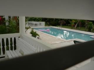 Looking through lounge window out onto the pool