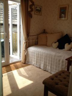 Daybed room through to balcony entrance