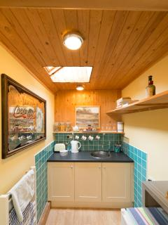 the kitchenette with microwave/ fridge/kettle/toaster.