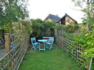 Sun trap cottage garden, with a gate to prevent pets wandering far.