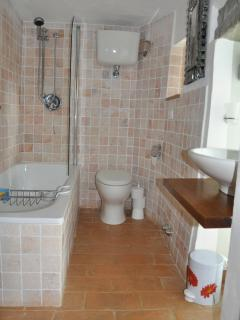 En-suite bathroom.  Bath and Shower, toilet and basin.  Functional and comfortable.