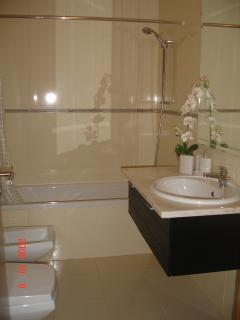Master Bedroom en-suite with Jacuzzi Bath & Shower, heated towel rail and hairdryer