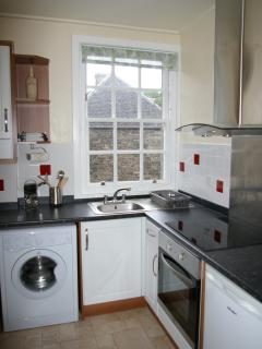 Fully fitted kitchen with washing machine, cooker and hob