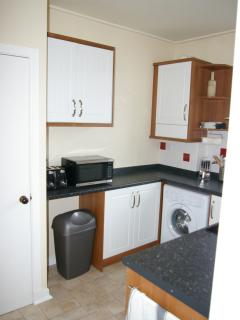Fully fitted kitchen with appliances