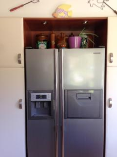 Large side by side refrigerator with mini bar, water and ice dispenser