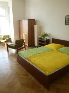 Double bed and lounge area in bedroom
