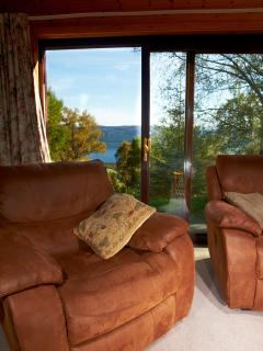 Comfortable Lounge with 3/2/1 reclining suite and view of Loch Ness