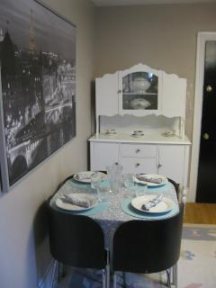 Seating for the maximum 3 guests, 2 sets of dishes including a set of china, linens, barware...