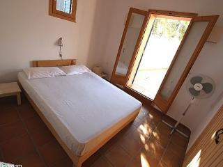 Bedroom # 1 opens to a large courtyard covered by vines with superb mountain view