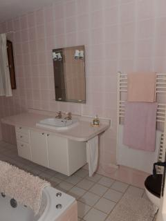 The Pink room en suite bathroom with bath and walk in shower