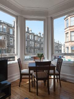 Dining at Bay Window Seats Up to Six Guests