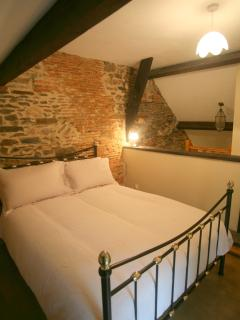 The hay-loft (3rd) bedroom has its own staircase, perfect for teenagers