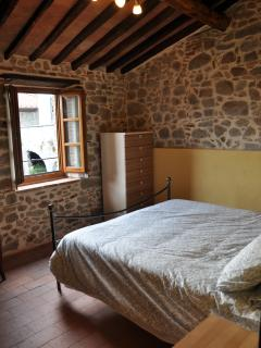 Master bedroom with stunning views across the serchio valley