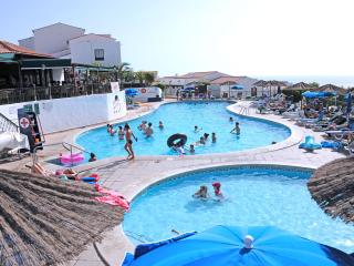 Heated swimming and paddle pools with overlooking bar-restaurant