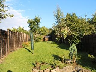 Beautifully cut grass in a very spacious garden for your whole family to enjoy