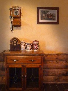 Nostalgia for a simpler time greets you in the Pioneer Suite of the Log House Lodge.