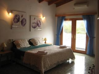 Master Bedroom of 55m2 with air conditioning and ceiling fan, terrace with mosquito nets.