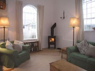 The beautifully furnished lounge with traditional vaulted windows and ceiling.