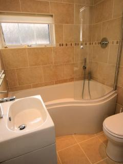 Family bathroom with bath with shower over and WC