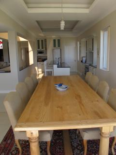 Dining room with8 seater solid oak imported table.
