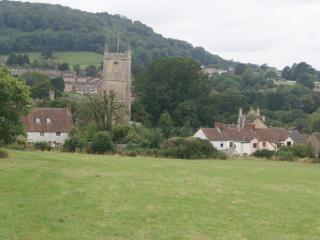 View of St Georges Church and the village of Upper Cam from the field behind Onespringbank.