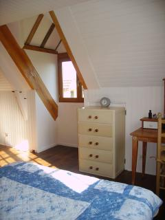 Master bedroom with views of the orchards. Catch a glimpse of the owls or bats at night.