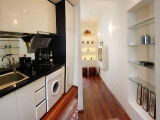 Sleek, compact kitchen with coffee maker, washer/dryer, microwave, refrigerator