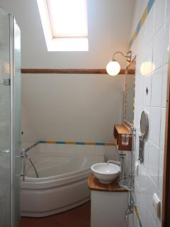 Family bathroom with separate shower cubicle. There's also a large shower room downstairs