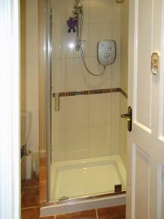 En suite, consisting of WC shower cubicle and hand basin