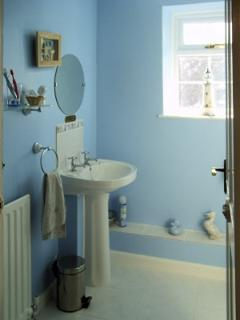 Family bathroom with shower cubicle, WC and hand basin