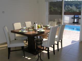 Indoor dining overlooks rear terrace.