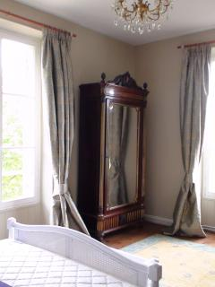 Spacious king bedroom with antique furniture
