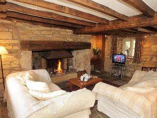 Sitting Room with beams, flagstone floor and log fire