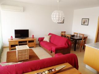 Another view of the open plan living room and dining area
