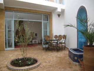 Courtyard with fountain and olive tre, leading into the salon